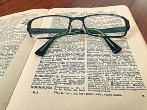 Dictionary and glasses